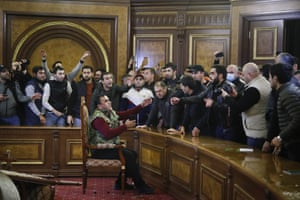Demonstrators argue after they broke into the government building protesting against an agreement to halt fighting over the Nagorno-Karabakh region.