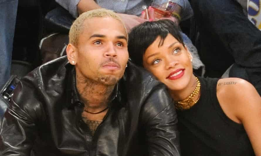 Chris Brown and Rihanna at a basketball game in 2012.