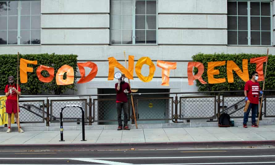 Protesters hold a banner reading 'Food Not Rent' during a rent strike demonstration in front of the downtown City Hall amid the coronavirus pandemic in Los Angeles in April 2020