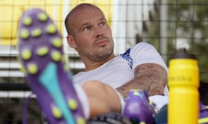 Freddie Ljungberg of Sweden watches as he rests during a training session ahead of the Hero Indian Super League in Mumbai.