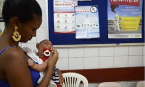 Zika virus outbreak, Brazil - 01 Feb 2016Mandatory Credit: Photo by Xinhua/REX/Shutterstock (5579897b) Gabrielly Santana da Paz holds her child who suffered microcephaly while waiting for examination at the Oswaldo Cruz Hospital, in Cabo de Santo Agostinho in northeastern Brazil Zika virus outbreak, Brazil - 01 Feb 2016