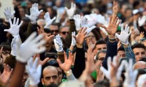 Deaf people raise their hands to applaud a speaker in Rome.