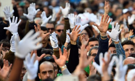Deaf people raise their hands to applaud a speaker in Rome.