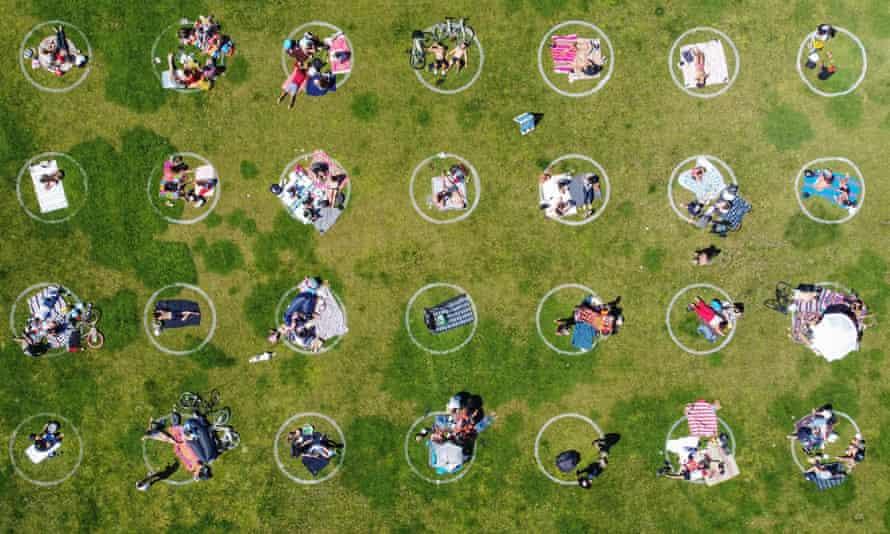 People keep within social distancing circles at Dolores Park in San Francisco, California.
