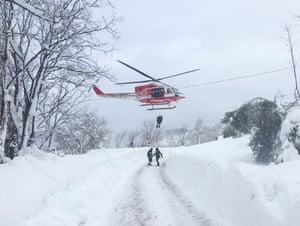 An injured person is airlifted to safety