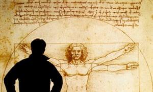 A man studies an electronic display of The Vitruvian Man 1490 by Leonardo da Vinci.