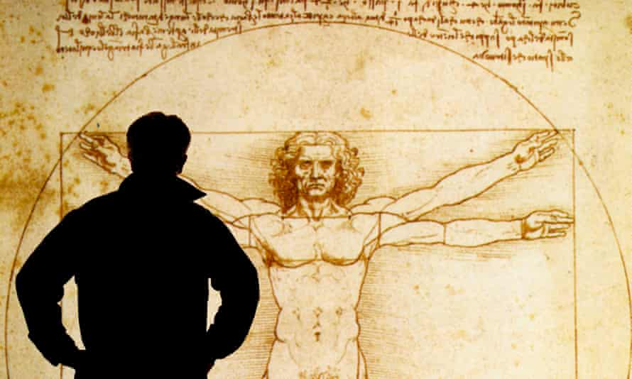 A person looks at an electronic display of The Vitruvian Man 1490, a drawing by Leonardo da Vinci.