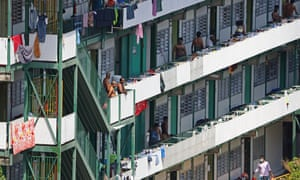 Foreign workers are seen outside their dormitory rooms at Cochrane Lodge II in Singapore