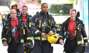 Firefighters at Grenfell Tower on the day of the disaster.