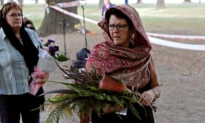 Women wearing scarfs are seen at Hagley Park outside Al Noor mosque in Christchurch.