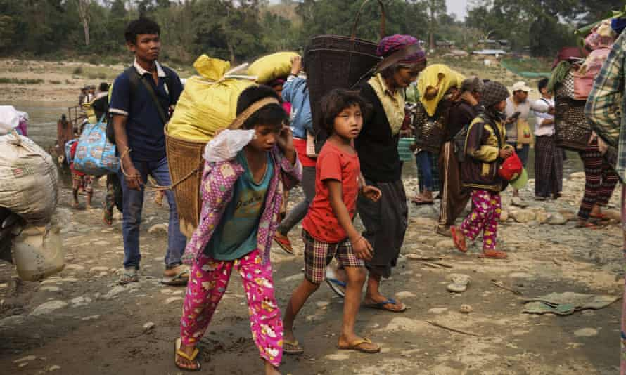 Kachin residents flee the fighting between the Myanmar army and ethnic insurgents.