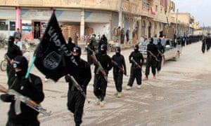 Islamic State fighters marching in Raqqa, Syria