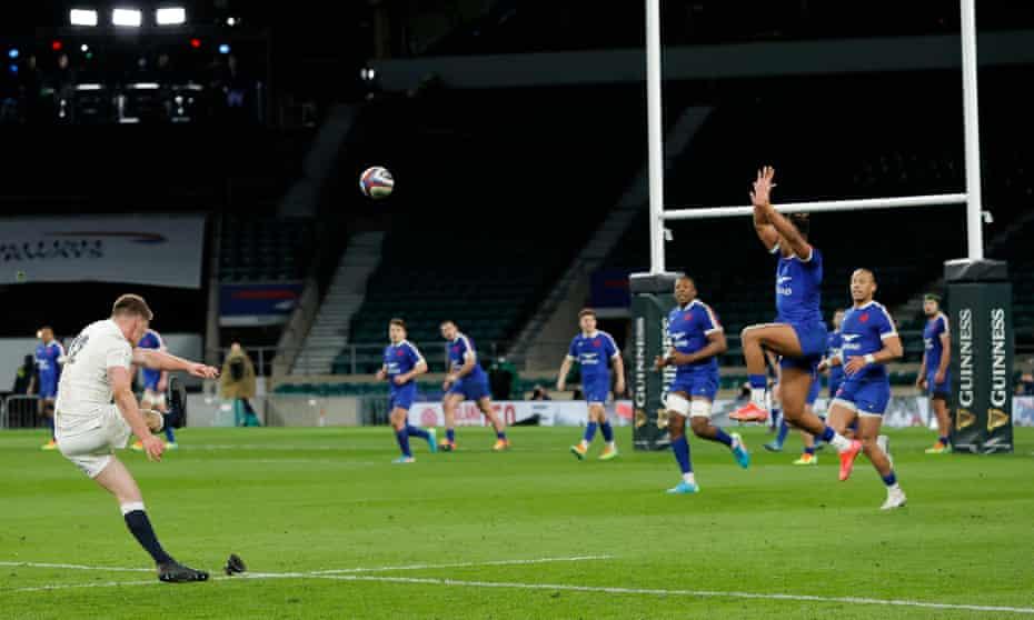 Owen Farrell kicks England's final conversion against France.