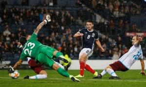 Scotland's John McGinn scores their second goal.