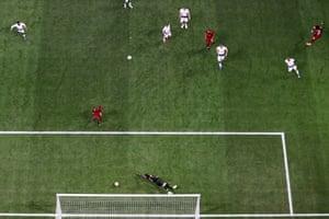 Divock Origi of Liverpool (right) scores his sides second goal past Hugo Lloris of Tottenham Hotspur.