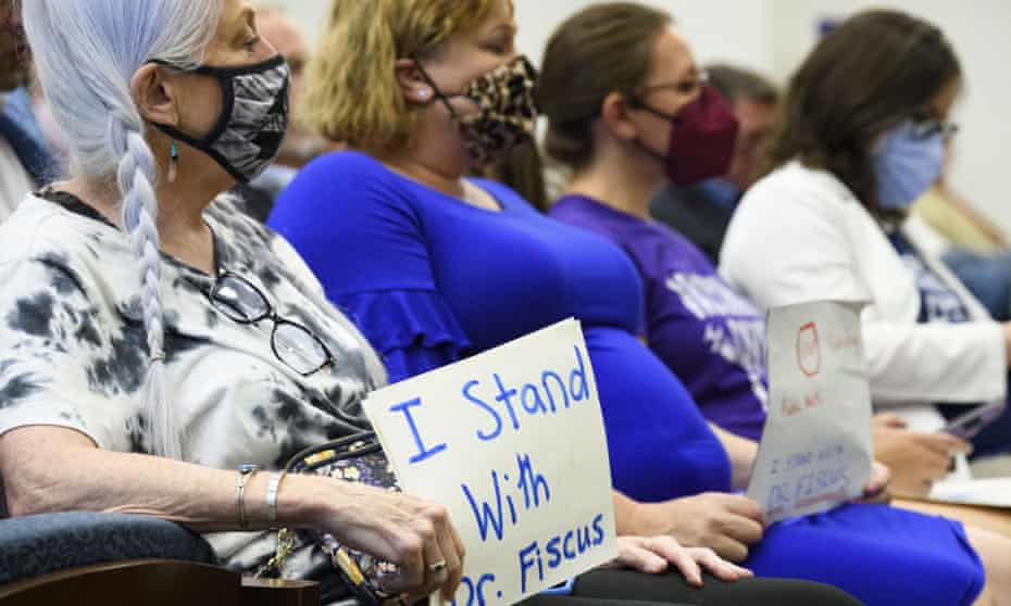 Vaccine advocates display signs in support of Michelle Fiscus at a state legislative committee meeting, 21 July, in Nashville.