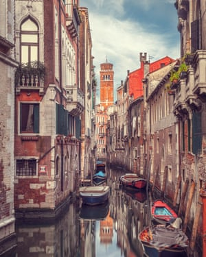 Canal plus: Venice with the tower of the Santa Maria Gloriosa dei Frari in the distance.