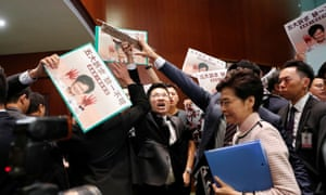 Hong Kong Chief Executive Carrie Lam arrives to deliver her annual policy address, as lawmakers shout protests, at the Legislative Council in Hong Kong.