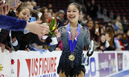 Alysa Liu greets fans while wearing her gold medal after winning the women's title at the US figure skating championships