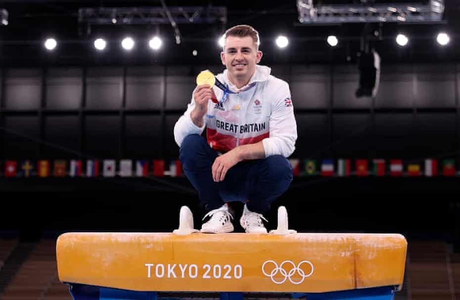 Max Whitlock celebrates winning gold in the men's pommel horse final at the Tokyo 2020 Olympic Games.