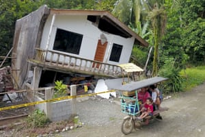 A house destroyed after an earthquake in Surigao City, the Philippines
