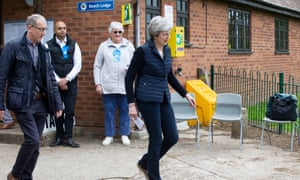Theresa May and her husband Philip at the polling station.