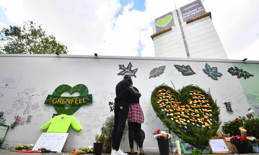 People at the Grenfell Memorial Community Mosaic on the third anniversary of the fire that claimed 72 lives on 14 June 2017.