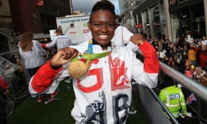 Nicola Adams poses with her Olympic medal during the victory parade.