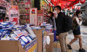 Masks and hand sanitiser on sale at a street stall in Tokyo.