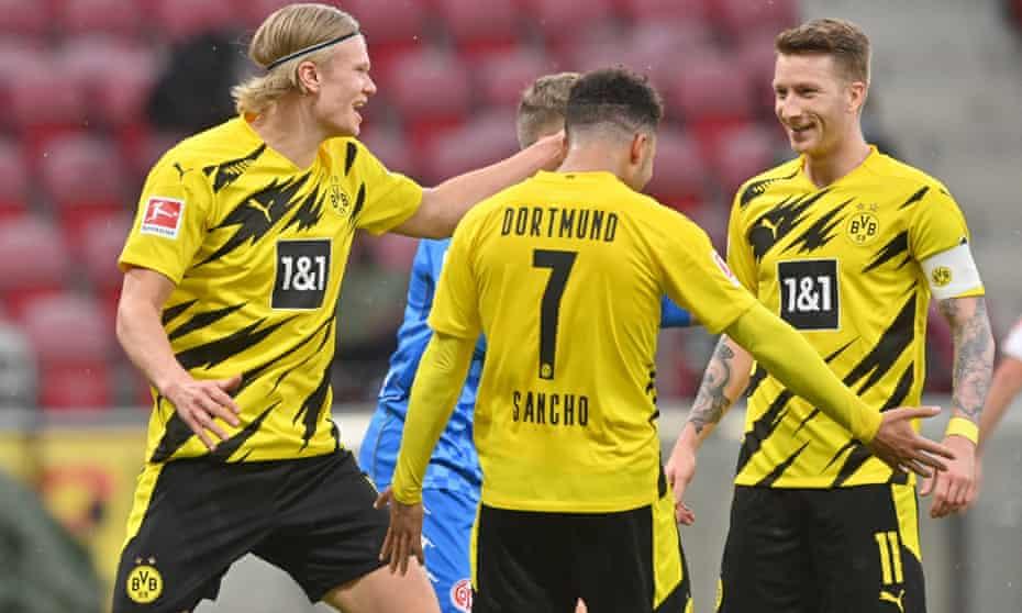Dortmund's Marco Reus (right) celebrates with teammates Erling Haaland (left) and Jadon Sancho.