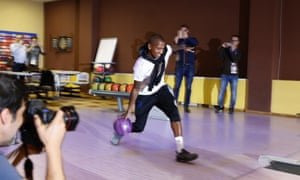 England's Ashley Young shows his bowling prowess at the training camp.