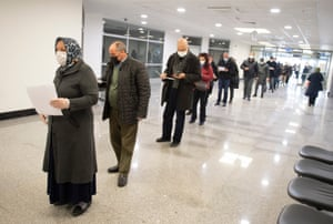 People wait in line to receive Pfizer BioNTech Covid-19 vaccine in Ankara City Hospital, Turkey, on 3 April, 2021.