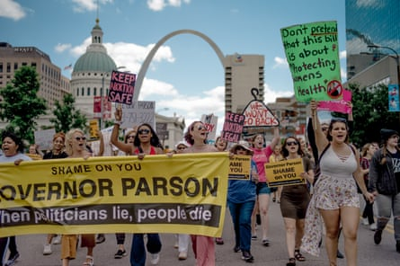Attendees chant and march through downtown St Louis during a rally and march to protest the closure of the last abortion clinic in Missouri on 30 May 2019.