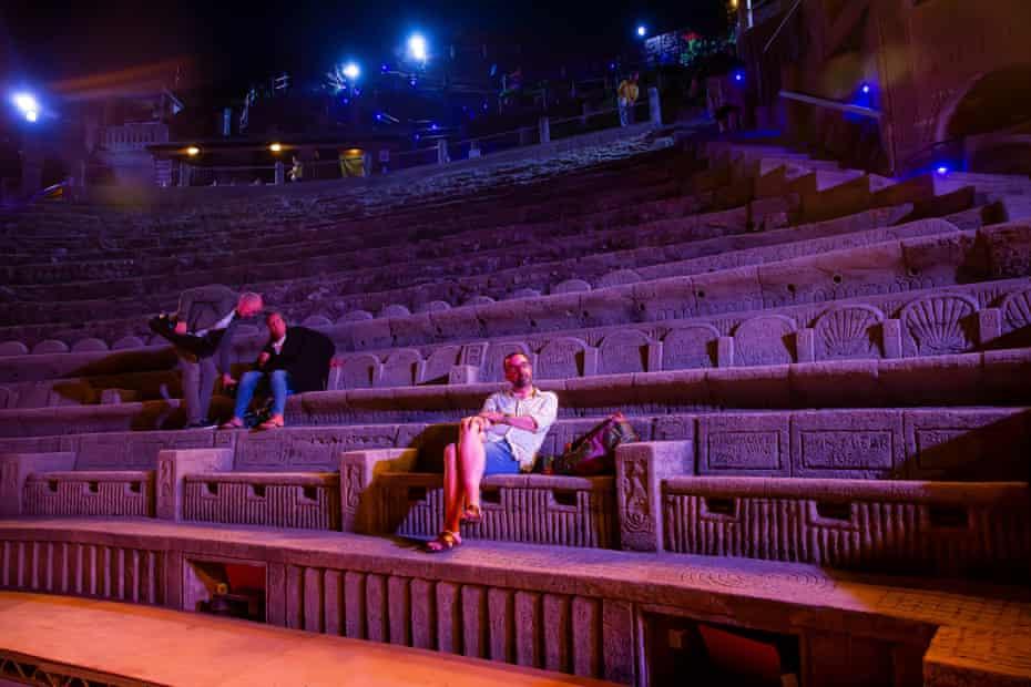 Adam Nichols sits in empty auditorium