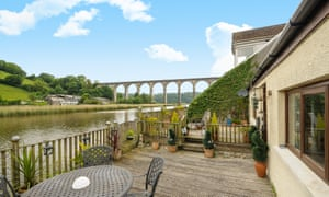 The Quay, Calstock, Cornwall From the sun deck that overhangs the river Tamar, the train viaduct is in one direction and green pastures the other. There's a private mooring below. It's a shame that all the rooms, including the bathroom, have to be accessed via the living room.Guide price: £359,000. Onthemarket.com, 01752 223933