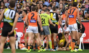 Dylan Shiel (second from left) and Trent Cotchin of the Tigers
