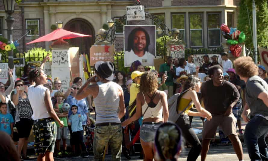 Protesters chant and dance in front of a memorial to Philando Castile on the gates of the governor's residence in St Paul, Minnesota in July 2016.