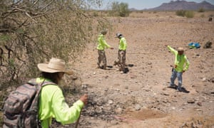 Final journey: search and rescue crew mark off an area where human remains have been found in the wilderness near Ajo, Arizona.