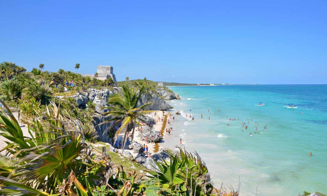 Wish you weren't here: tourists swim in sea at Tulum, Mexico.