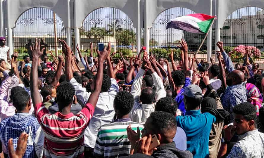 Sudanese protesters outside the presidential residence and military HQ in Khartoum.
