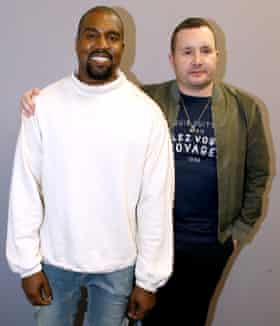 Menswear designer Kim Jones with Kanye West at Paris fashion week, June 2015