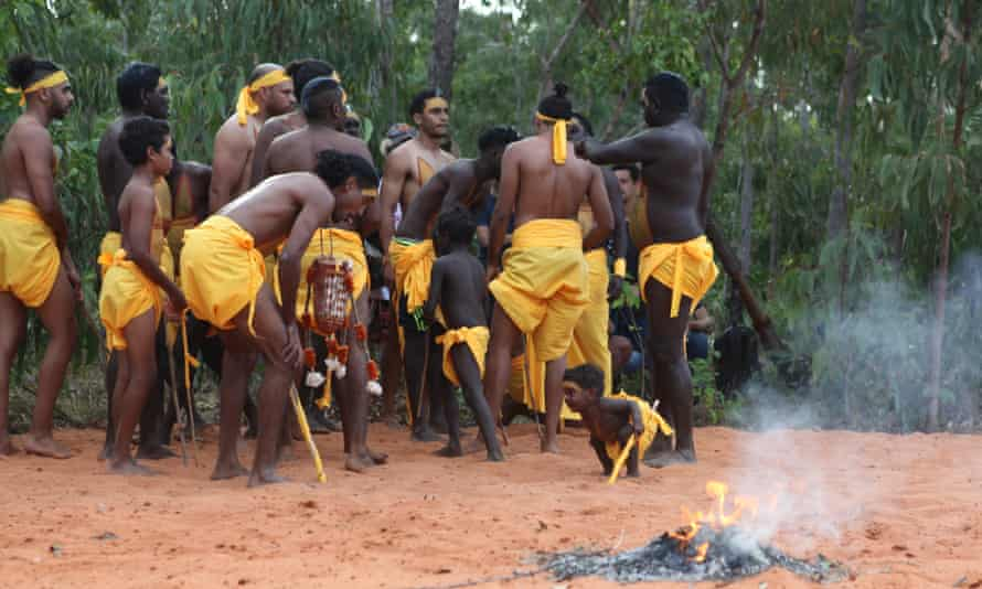 Cedric Marika and a young boy during an interval at the opening ceremony of the Garma festival