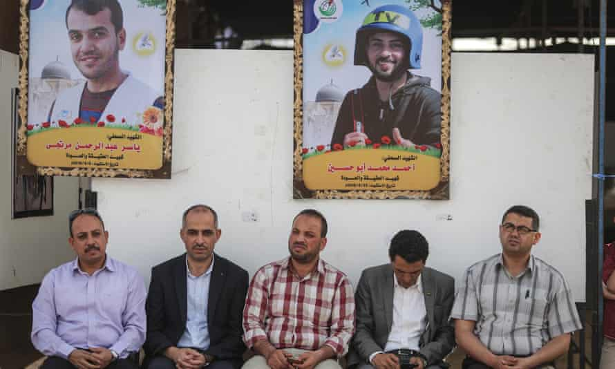 Images of press members Yaser Murtaja (top left) and Ahmad Abu Hussein (top right), who were shot dead by Israeli soldiers while covering border demonstrations, are displayed at an exhibition organised by the Palestinian Media Community in Gaza City last week