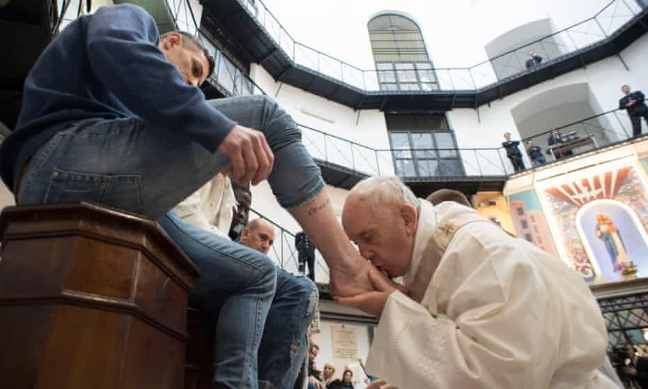 Pope Francis washes the feet of inmates of a prison in Rome on Maundy Thursday in 2018.
