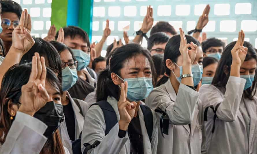 Medical students hold up the three finger salute at the funeral of Khant Nyar Hein in Yangon on Tuesday.