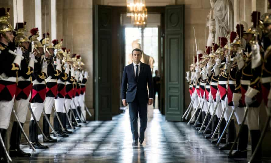 French President Emmanuel Macron walks through the Galerie des Bustes (Busts Gallery) to access the Versailles Palace's hemicycle for a special congress gathering both houses of parliament