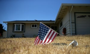 A drooping American flag in front of a home in California