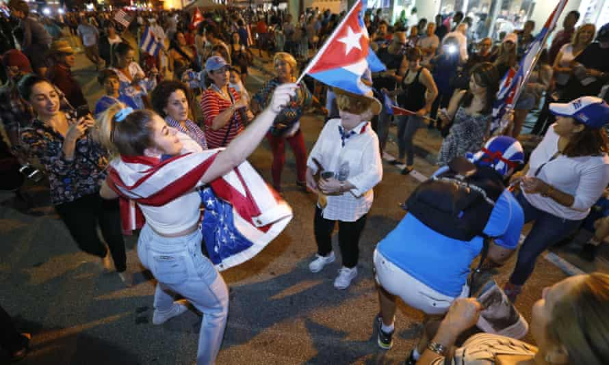members of the Cuban community dance in the street following the death of Fidel Castro