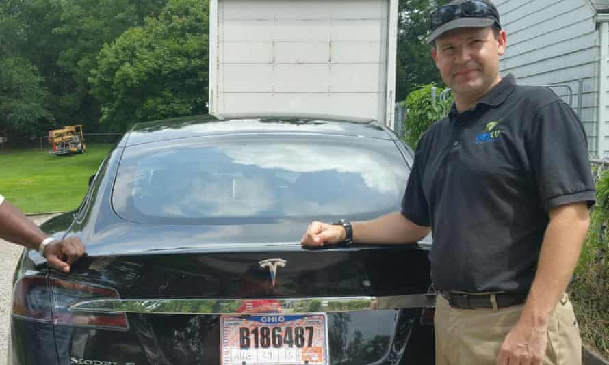 Joshua Brown, who died in a crash in Florida, poses with his Tesla Model S in 2015.