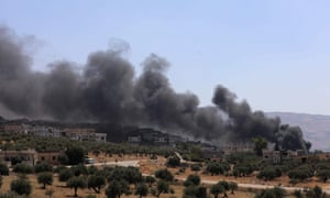 Smoke rises from buildings that were hit by reported Russian air strikes in the rebel-hold town of Muhambal, about 30 kilometres southwest of Idlib